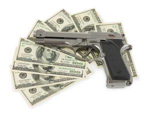Handgun and 100 dollar bills