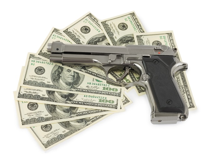 Handgun and 100 dollar bills