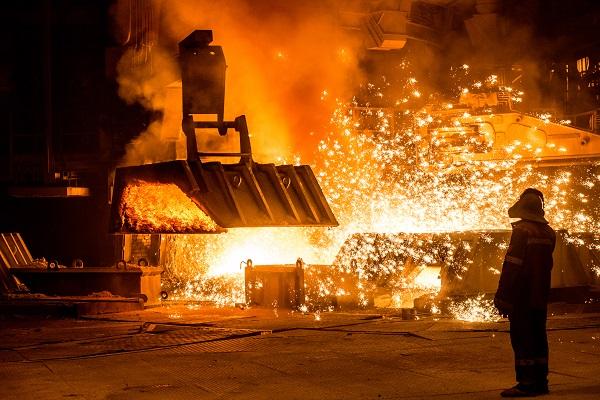 Steelworker near a blast furnace resize