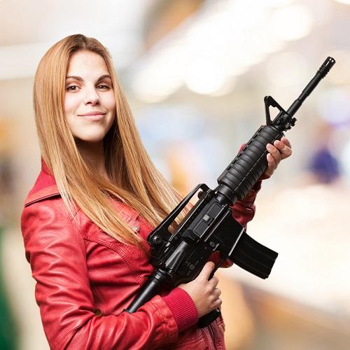 blond woman with a gun