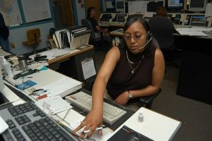A dispatcher takes an emergency call