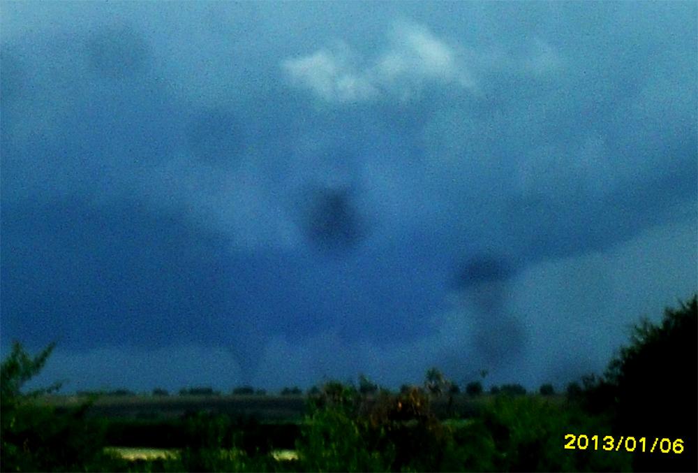 Tormentas, tornado, destrozos e inundaciones