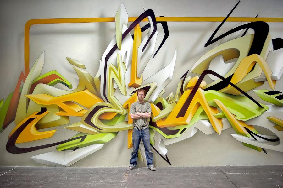 German artist DAIM in front a unique 3D-style piece of graffiti art
