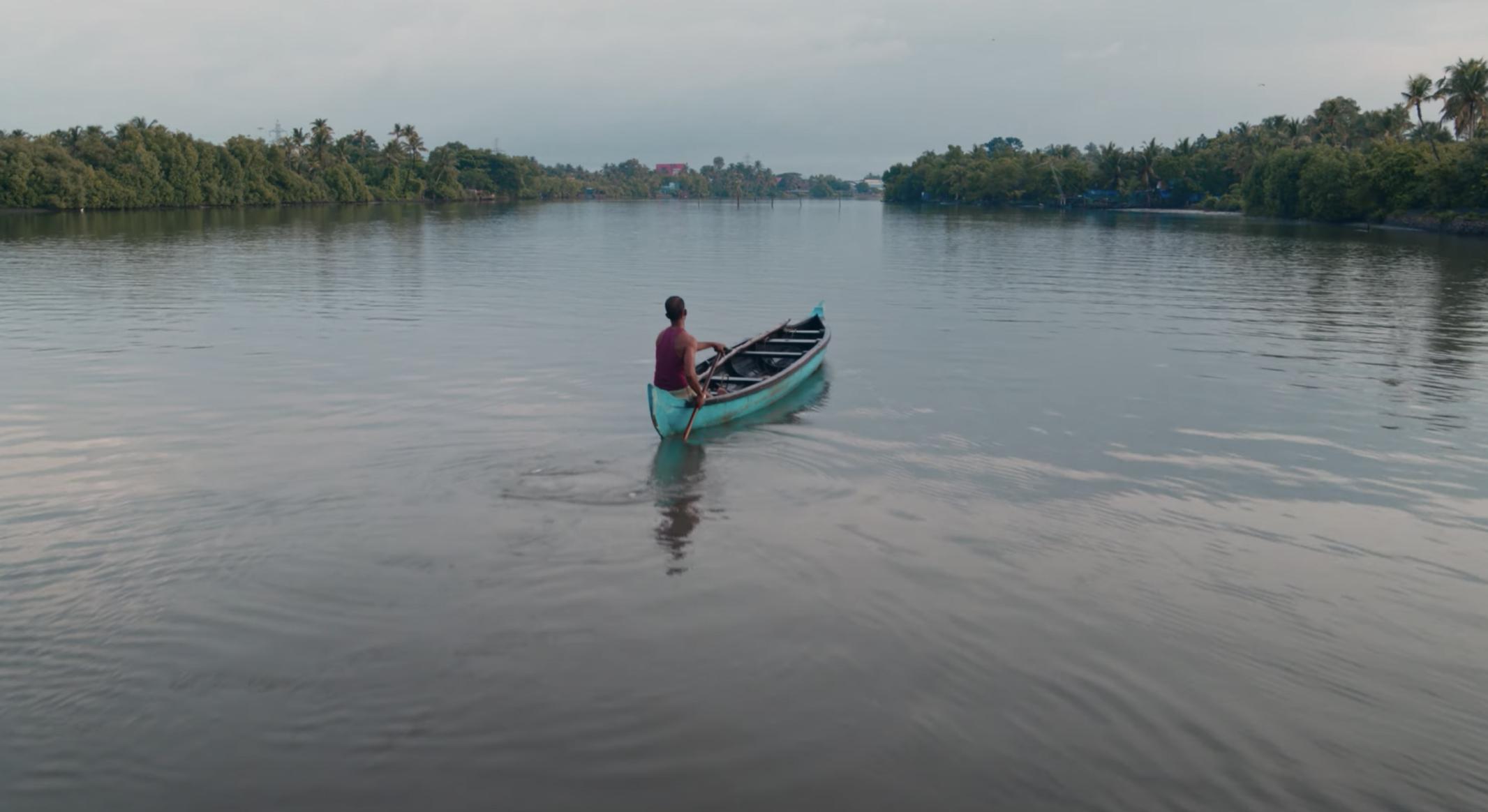 Fisherman on river in Kerala India.