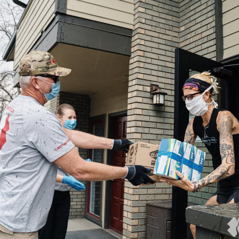 Team Rubicon volunteers handing out essential supplies.