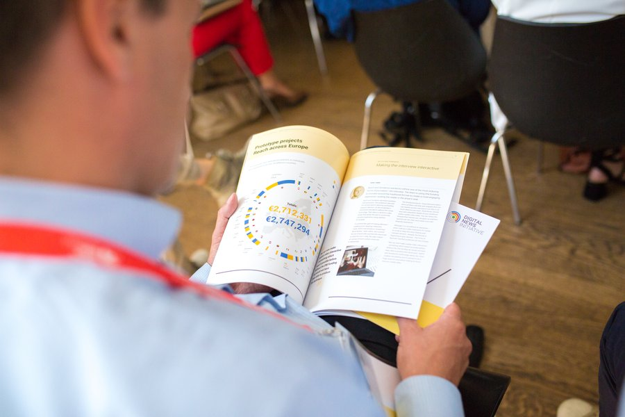man reading dni innovation fund report