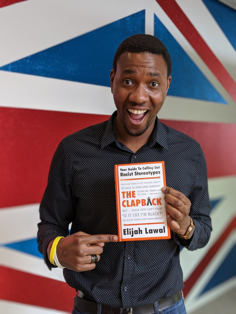 Elijah Lawal poses with his book