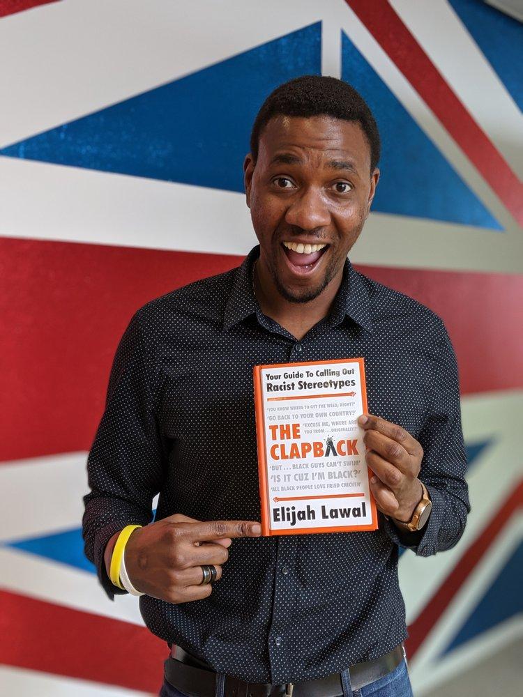 Elijah Lawal with his book.