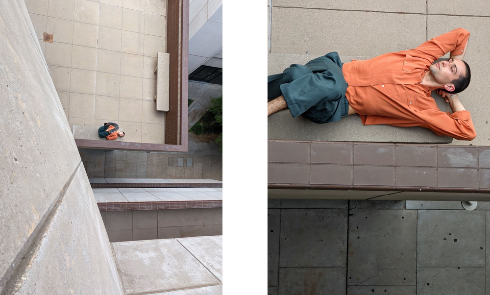 Photo of person relaxing on a bench, taken from top of building.