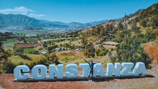 Juan in front of Constanza sign.