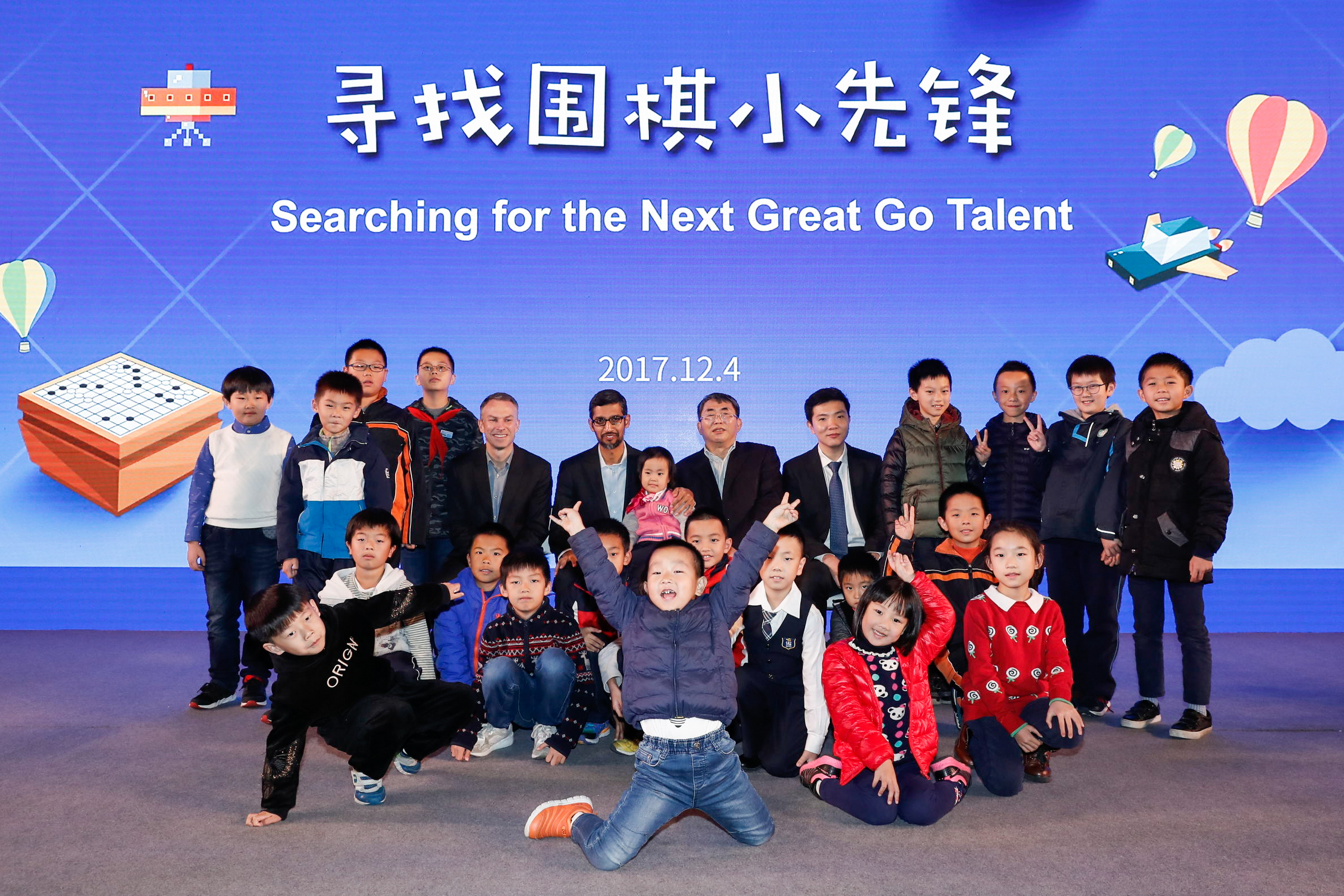 Google CEO Sundar Pichai with students of the Nie Weiping Go School