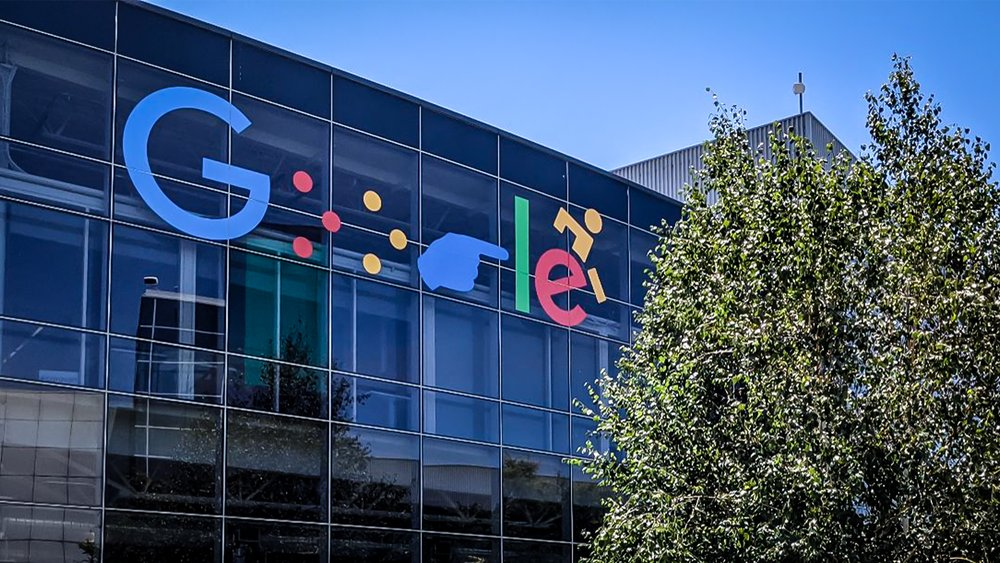 Google logo on Google's main campus building B43 featuring Braille as the 'o's, ASL for 'g', and a wheelchair user as 'e'.
