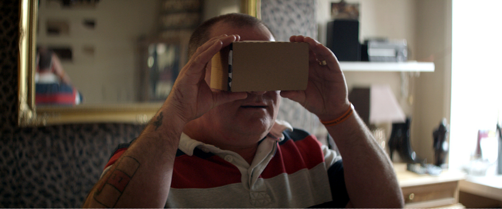 "A man tries out the ""A Walk through Dementia"" app using a virtual reality viewer"