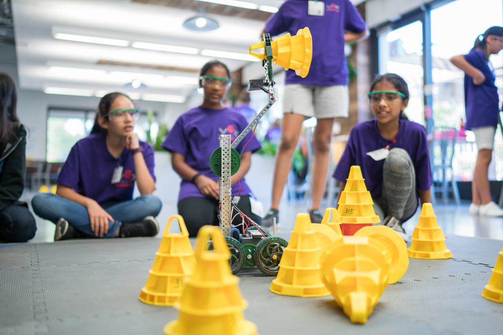 Girl Scouts at a robotics competition