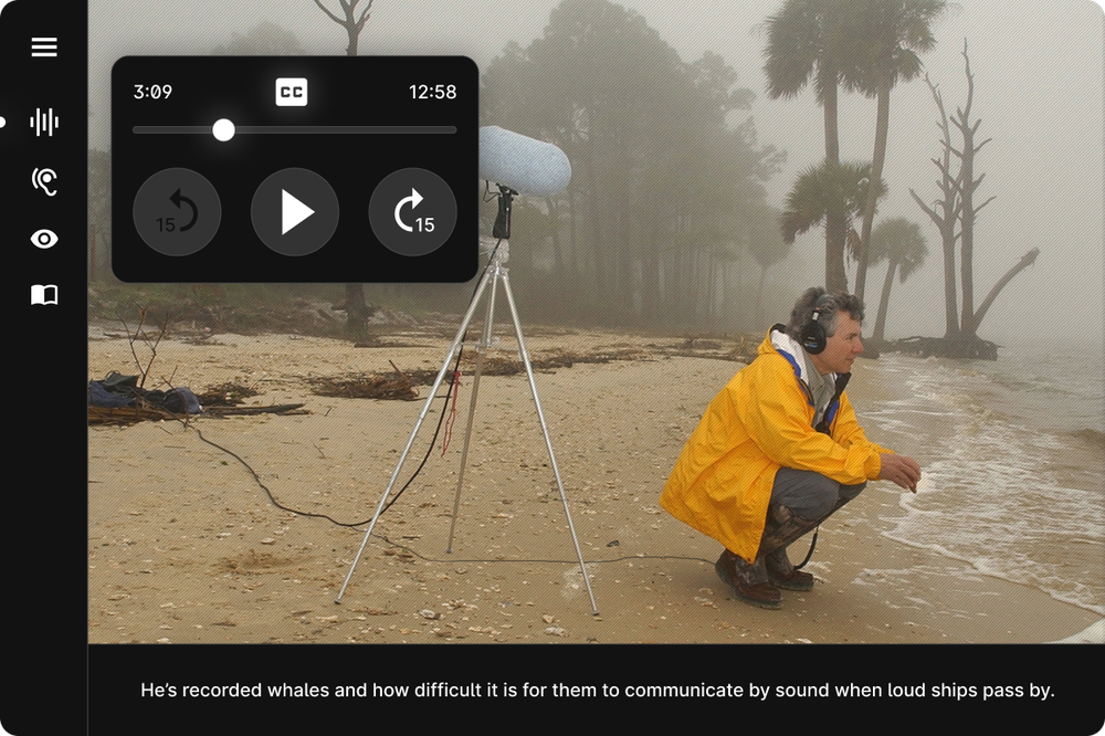 A screenshot from online stoytelling experience Auditorial shows an image of Bernie Krause kneeling down beside the ocean, recording the waves. Closed captions at the bottom of the screen read 'He's recorded whales and how difficult it is for them to communicate when loud ships pass by'.