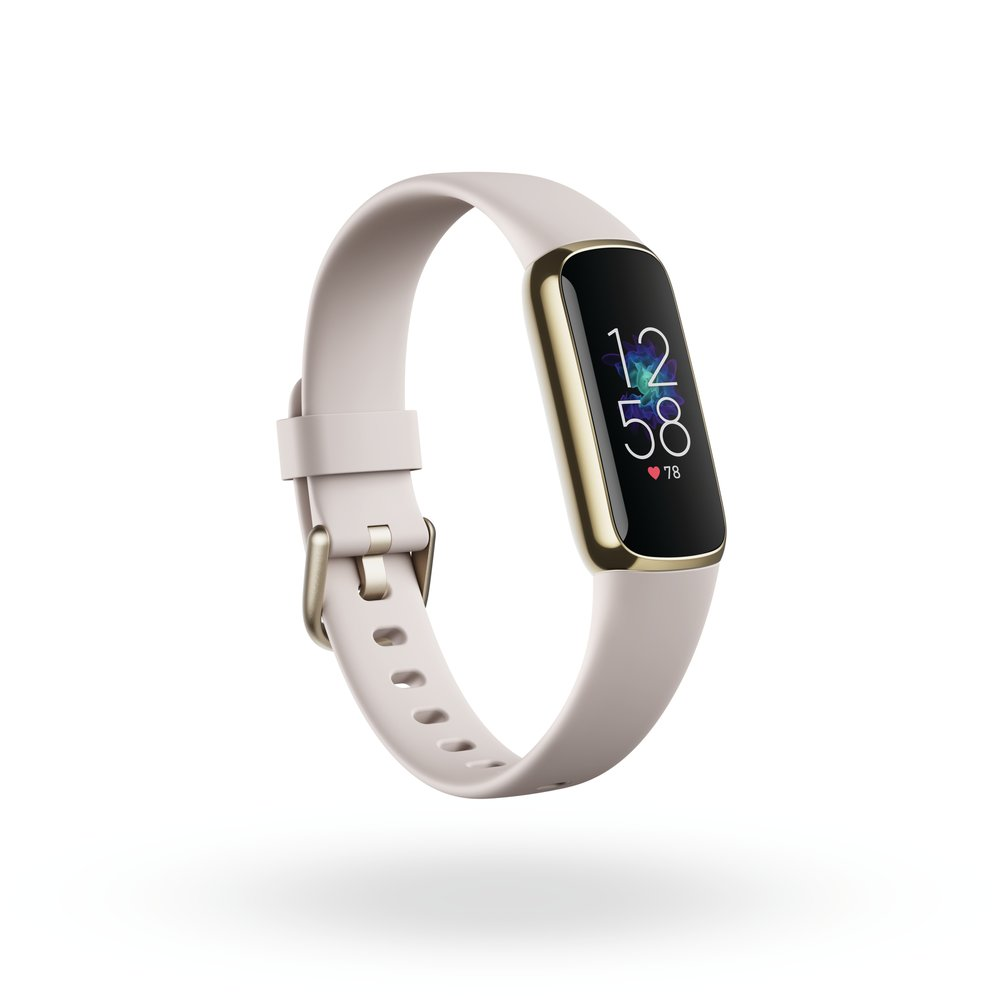 The Fitbit Luxe with a white band, floating in front of a white background. The display features the time and heart rate.