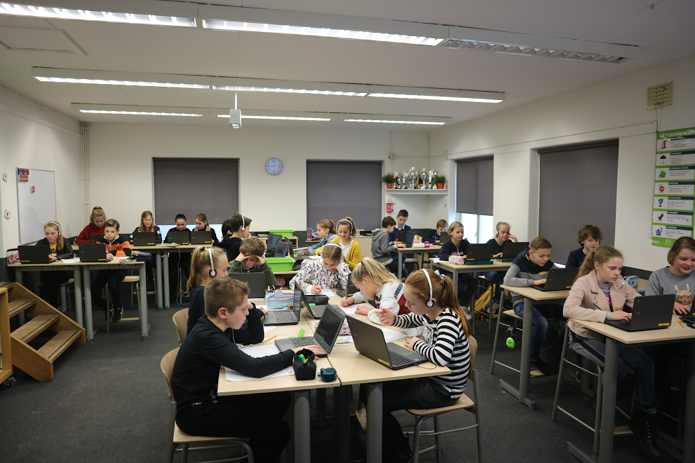 Children using Chromebooks in a classroom.