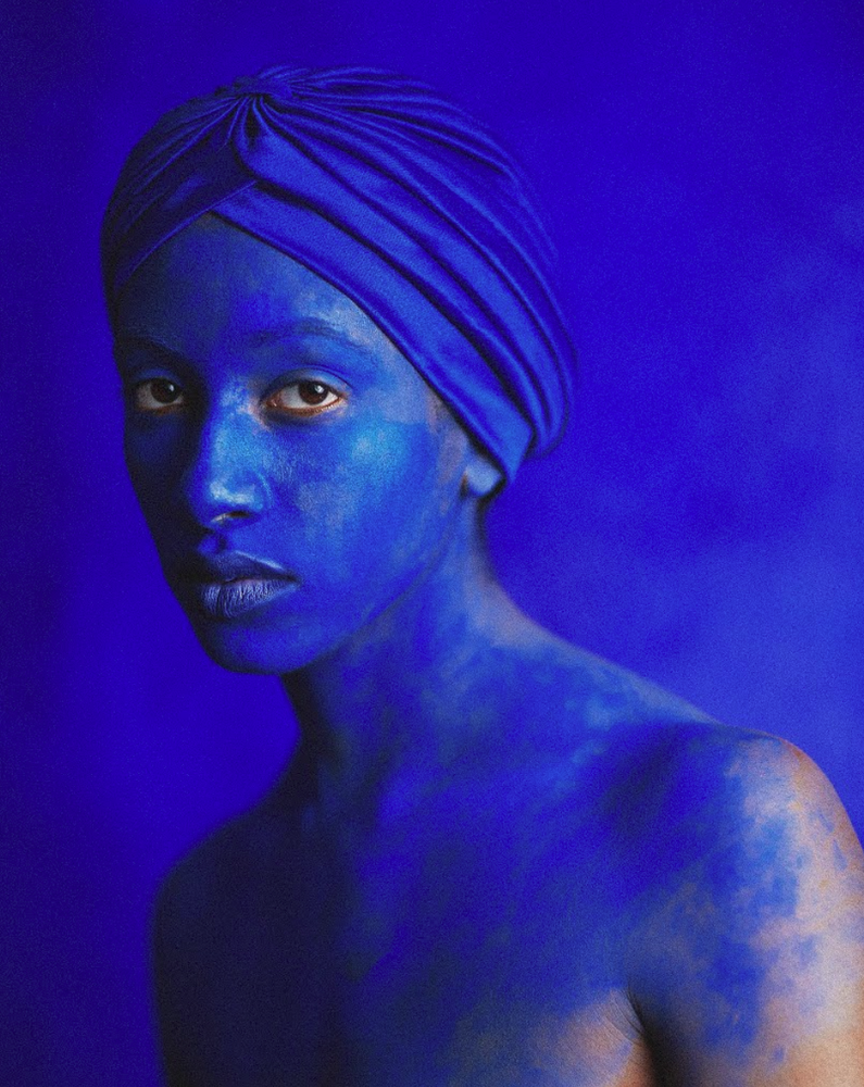 Foto of womans face painted blue.png