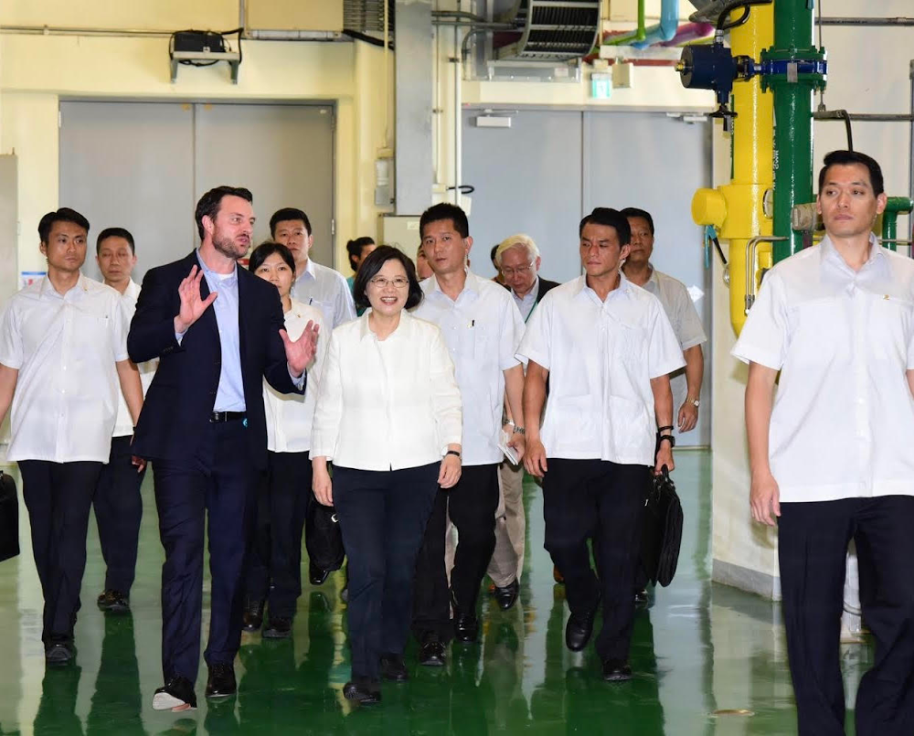 A group of people walking through a data center.