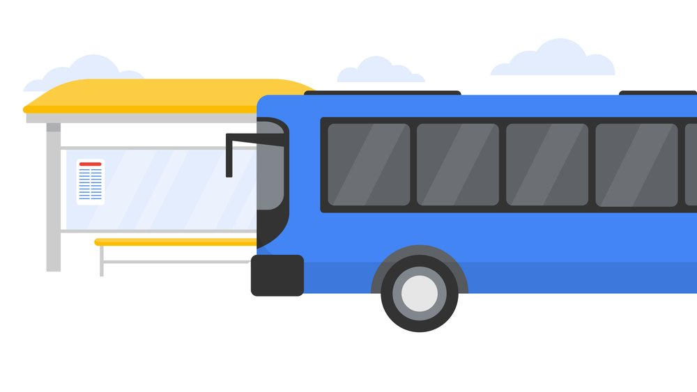 Image of a bus in front of a bus stop