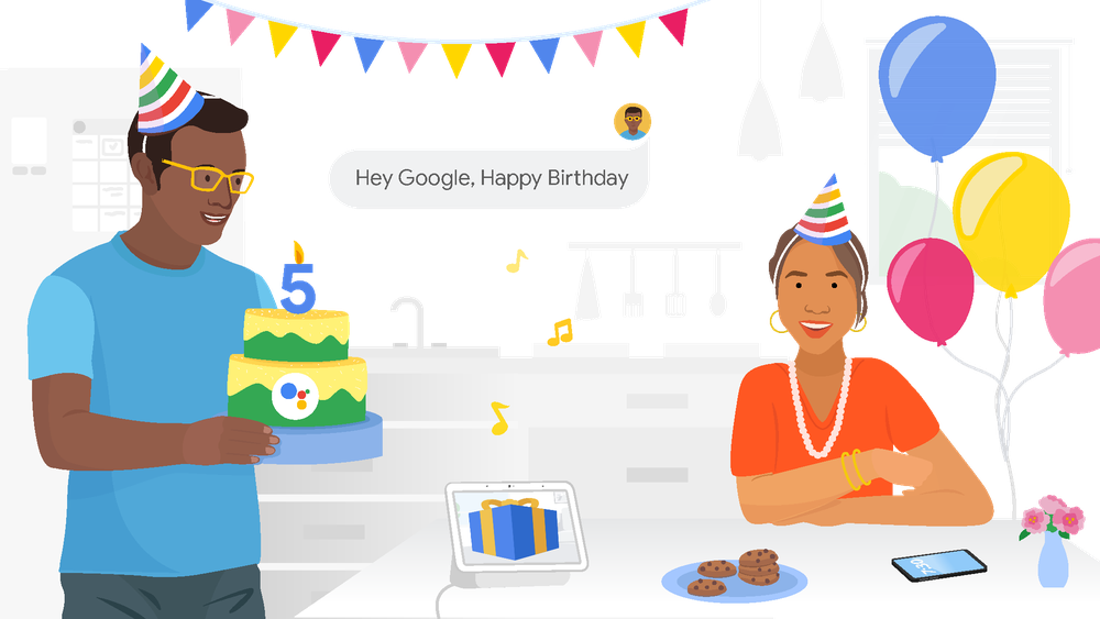 """A man holds a cake with a number 5 candle and the Google Assistant logo, while a woman sits at a table. Both wear party hats, and a text bubble in the background reads """"Hey Google, Happy Birthday"""""""