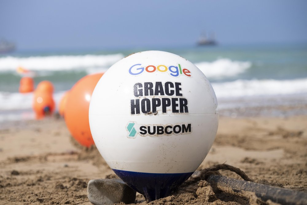 An image of the Google buoy landing on the sandy beach of Bude, Cornwall