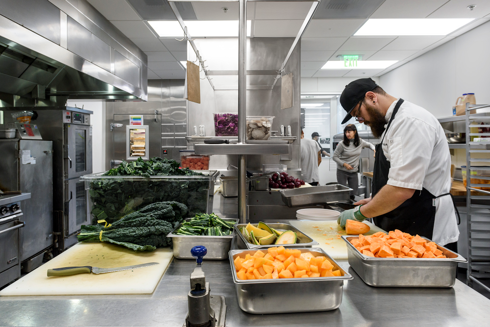 Chefs prepare vegetables in a Google kitchen