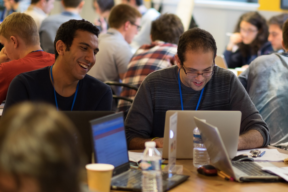 Teams work together to schedule satellite operations during the 2016 Hash Code Final Round at Google Paris.