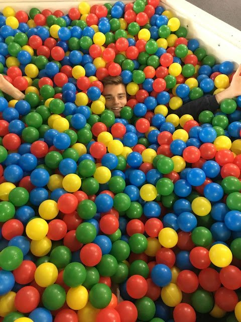 Steven in a ball pit.