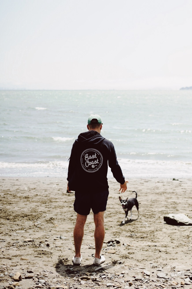 Bobby on the beach with his dog