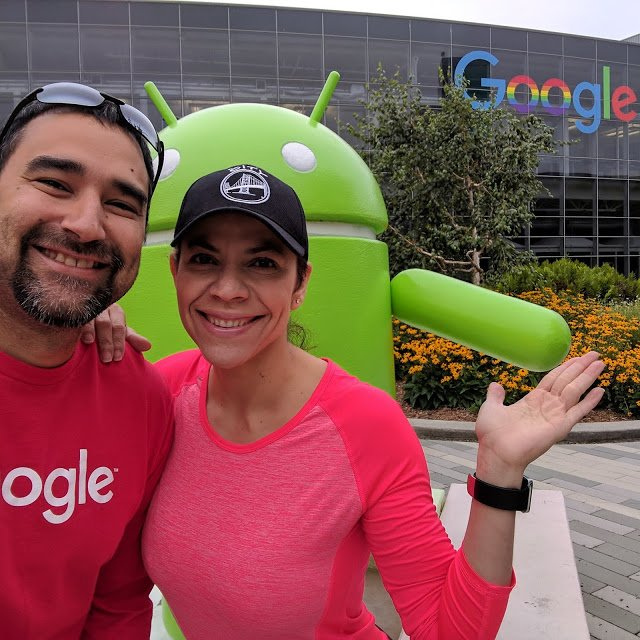 Jesus and his wife pose outside with an android statue at Google headquarters.