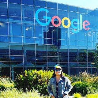 Callen standing under Google sign.