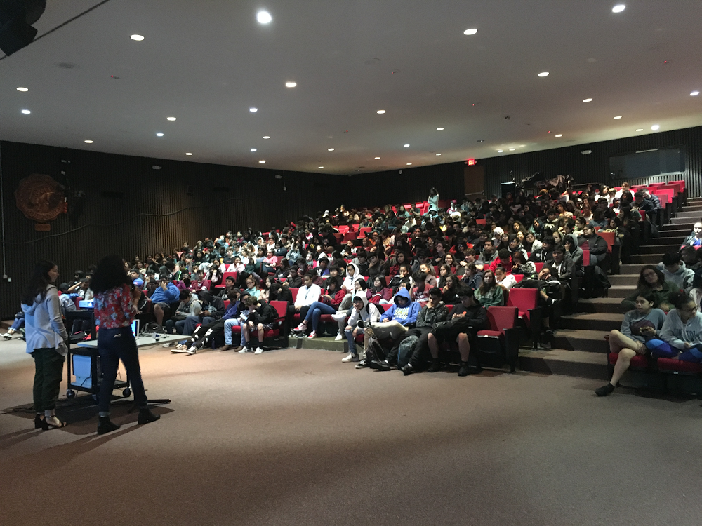 An auditorium filled with students.