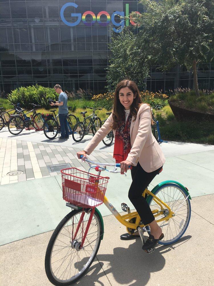 Dina on a Google bike outdoors.
