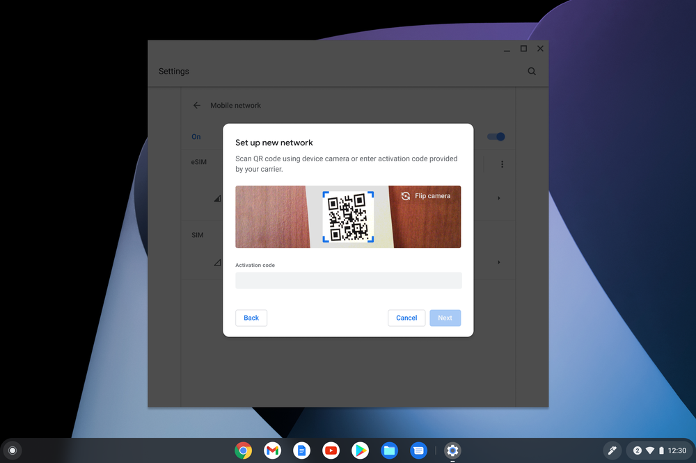 A dialog box prompts a user to take a picture of a QR Code during network setup.