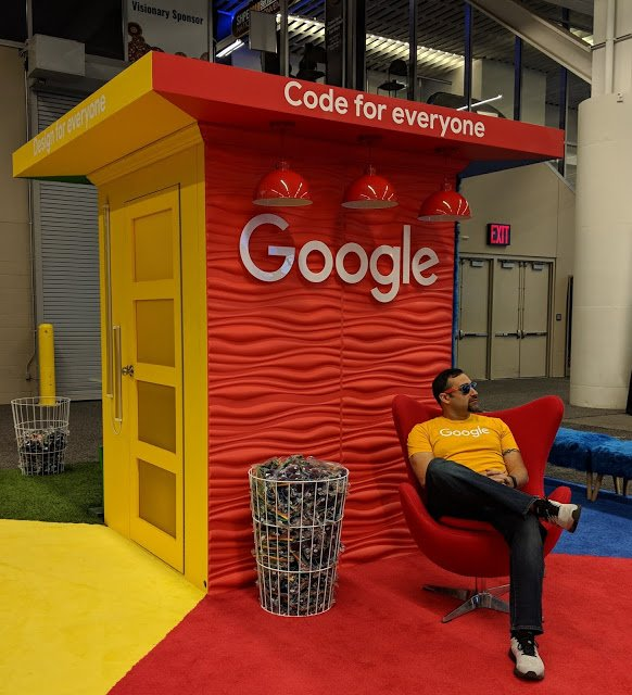 Jesus sitting in a chair at a Google career fair booth.