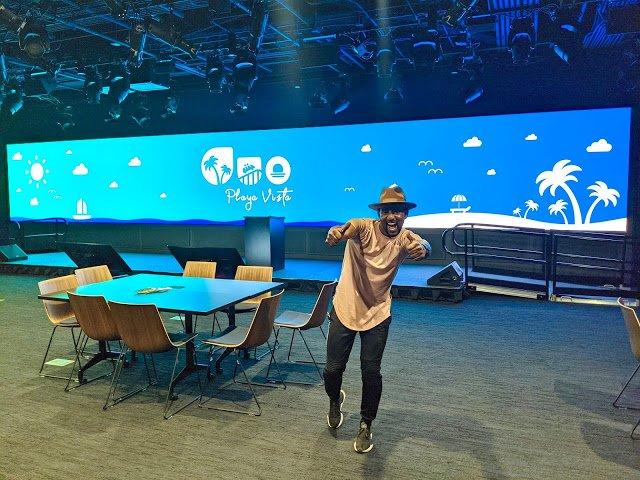 Juan standing in event space.