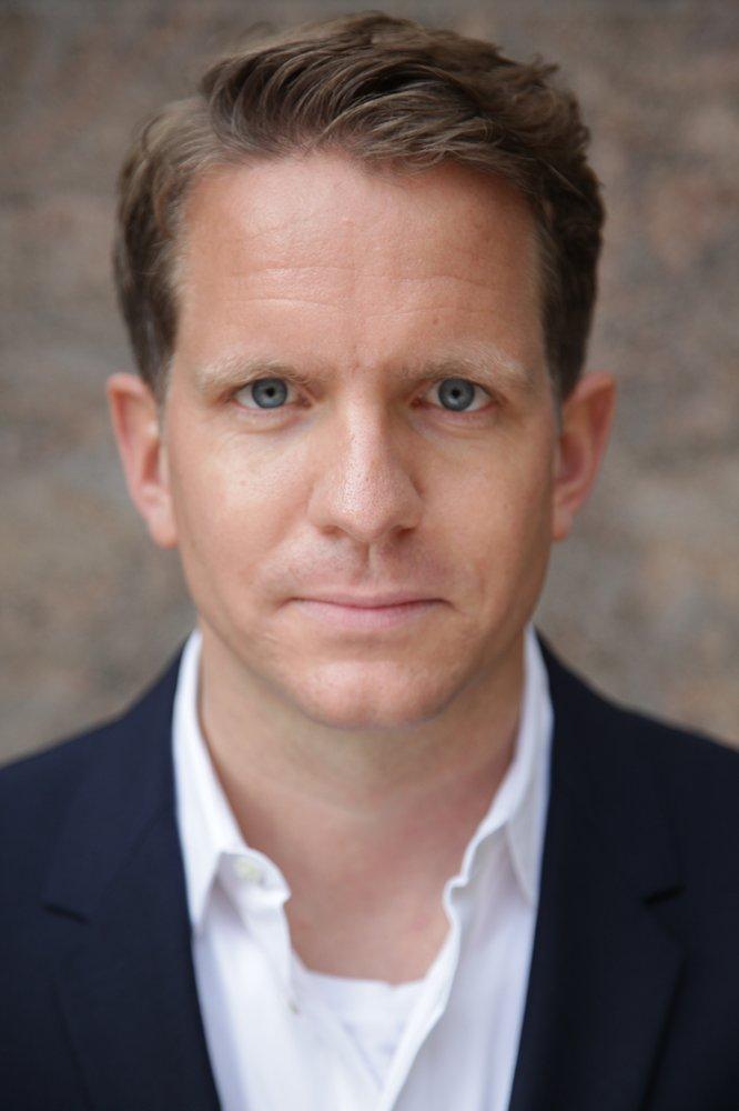 Ein Foto zeigt Michael Firnhaber im Porträt