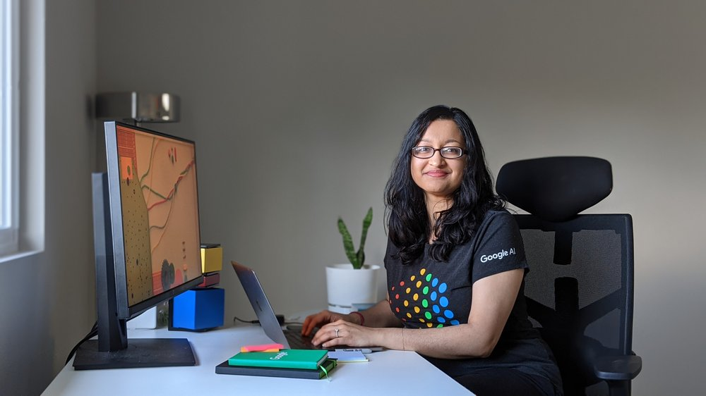 Preeti sitting at her desk at home