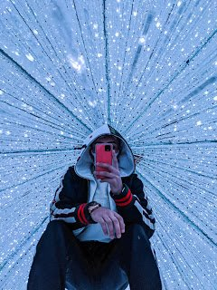 Rahul holding Pixel phone in light tunnel