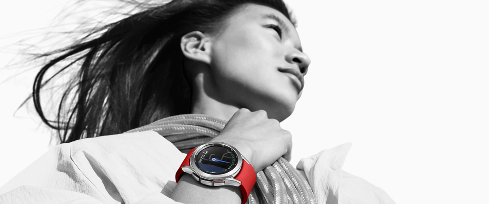Woman wearing red watch with Google Maps