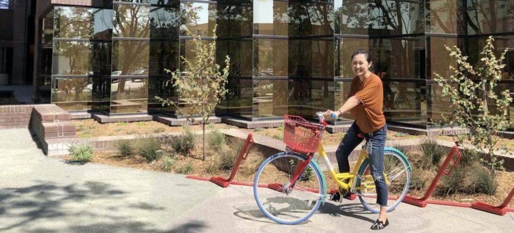 Belle on a Google bike outside.