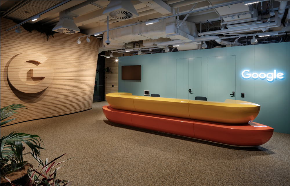 A photo of the canoe-shaped front desk at Google's new, purpose-built office in Auckland, New Zealand
