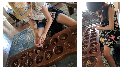 Two photos side by side, each with a girl with their head down in a living room, actively playing Sungka. The game is made of a long wooden piece with 16 holes and many shells.