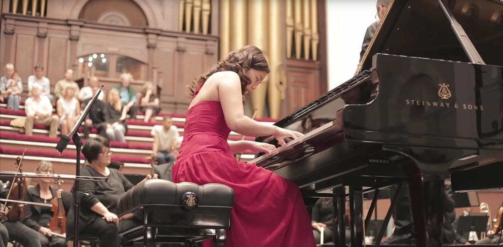 June Wu playing piano
