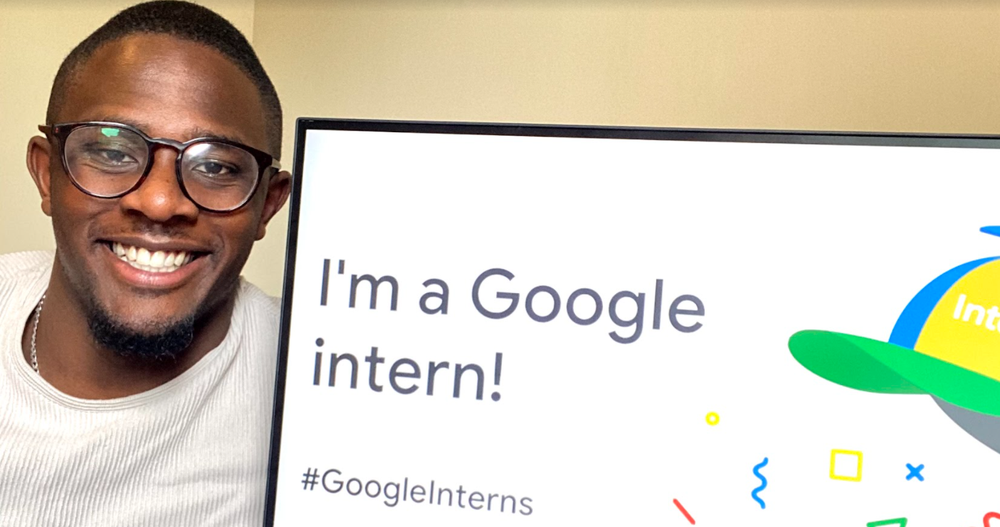 A picture of James Frater smiling next to a computer screen saying 'I'm a Google intern!'