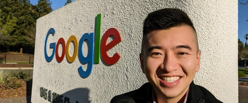 Shawn Sieu, Head of Learning & Development at Google, standing outside in front of a Google sign