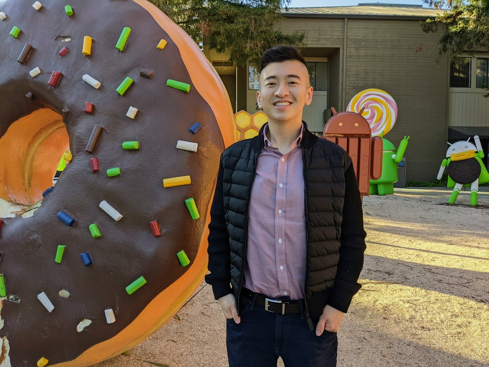 Shawn Sieu, standing in front of the android statue park on the Google campus.