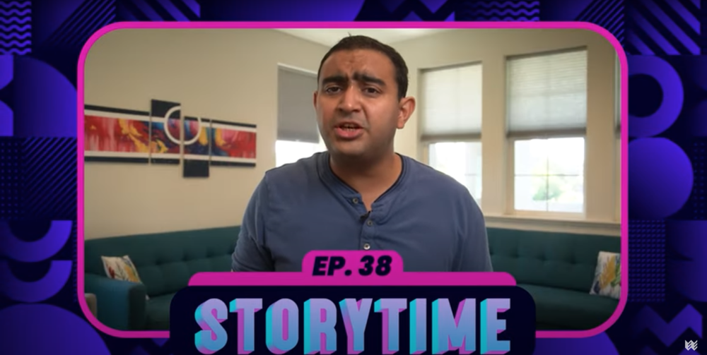 """A man in a dark blue shirt stands in a room with color artwork, windows and a wraparound couch in the background. He is speaking to the camera, and a caption below reads """"Ep. 38 Storytime."""""""