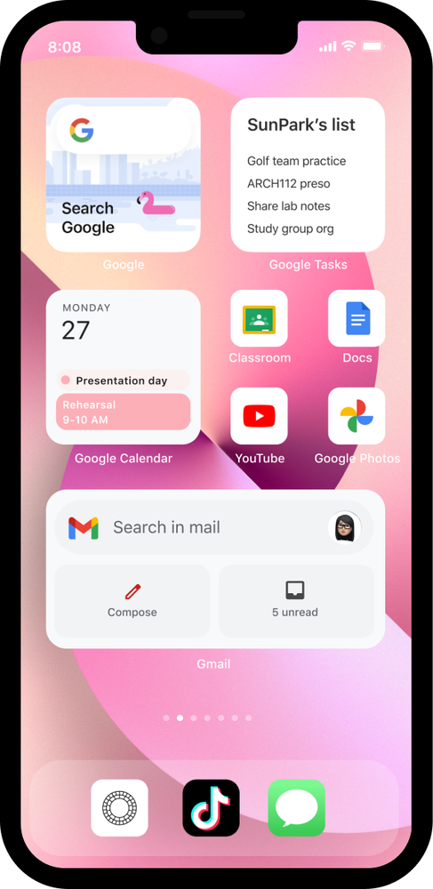 iPhone 13 with a pink background showing a widget set-up with the Google app, Keep, Gmail and Google Calendar.
